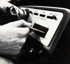 [photo of credit card being inserted into dashboard]