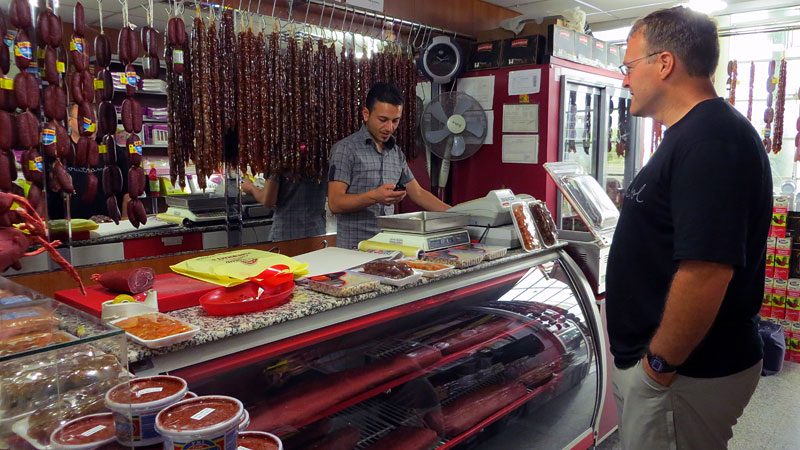 Nick, shopping for cured meat at the bus station.