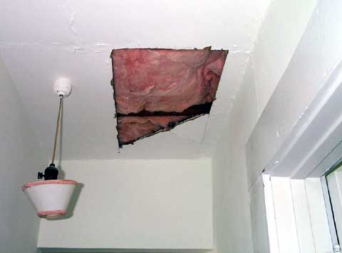 [The hole in the ceiling caused by the insulation contractors]