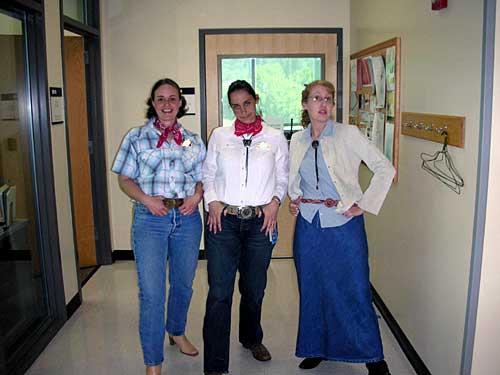 [photo of Rhonda, Celeste, and Kris posing as cowgirls]