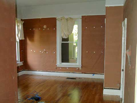 [Day one of the drywall project -- the den]
