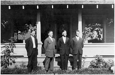 [photo of four young Mennonite boys]
