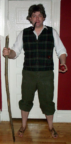 [photo of me as a hobbit, apple and walking stick in hand]