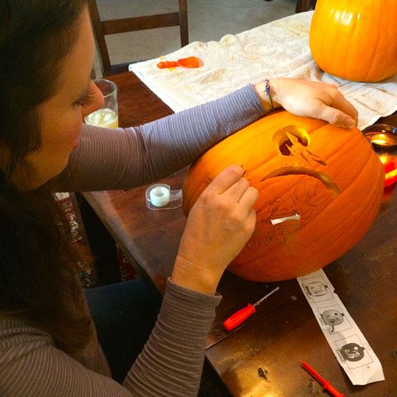 Kim carves her first pumpkin
