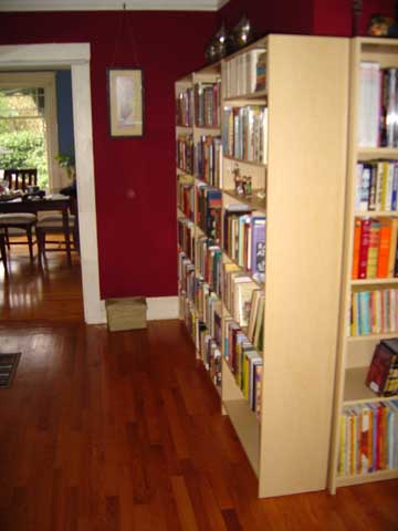 [photo of main wall of books]