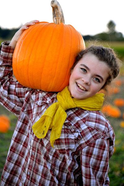 Reagan with her pumpkin