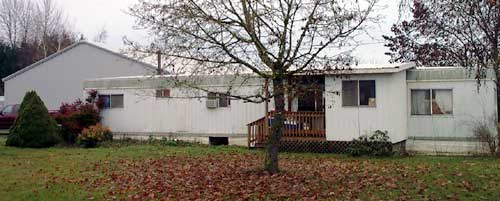 [photo of trailer house in which our offices are housed]